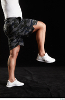 Grigory  1 camo shorts dressed flexing leg side view sports white sneakers 0004.jpg