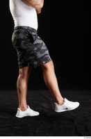 Grigory  1 camo shorts dressed flexing leg side view sports white sneakers 0005.jpg