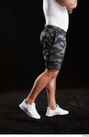 Grigory  1 camo shorts dressed flexing leg side view sports white sneakers 0006.jpg