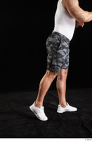 Grigory  1 camo shorts dressed flexing leg side view sports white sneakers 0007.jpg