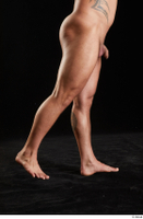 Grigory  1 flexing leg nude side view 0006.jpg
