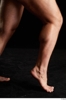 Grigory  1 calf flexing nude side view 0009.jpg