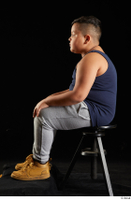Vano  1 blue tank top brown workers dressed grey sweatpants sitting sports whole body 0001.jpg