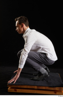 Johnny Reed  1 business dressed grey trousers kneeling shoes white shirt whole body 0003.jpg