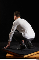 Johnny Reed  1 business dressed grey trousers kneeling shoes white shirt whole body 0004.jpg