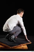 Johnny Reed  1 business dressed grey trousers kneeling shoes white shirt whole body 0006.jpg