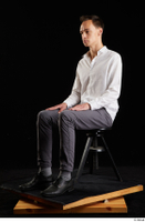 Johnny Reed  1 business dressed grey trousers shoes sitting white shirt whole body 0008.jpg