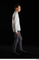 Johnny Reed  1 business dressed grey trousers shoes side view walking white shirt whole body 0003.jpg