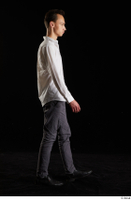 Johnny Reed  1 business dressed grey trousers shoes side view walking white shirt whole body 0004.jpg