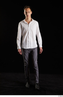 Johnny Reed  1 business dressed front view grey trousers shoes walking white shirt whole body 0003.jpg