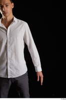 Johnny Reed  1 arm business dressed flexing front view white shirt 0001.jpg