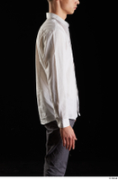 Johnny Reed  1 arm business dressed flexing side view white shirt 0001.jpg