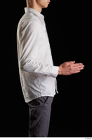 Johnny Reed  1 arm business dressed flexing side view white shirt 0003.jpg