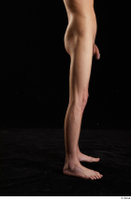 Johnny Reed  1 calf flexing nude side view 0001.jpg