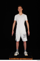 Johnny Reed dressed grey shorts sneakers sports standing white t shirt whole body 0001.jpg