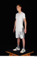 Johnny Reed dressed grey shorts sneakers sports standing white t shirt whole body 0002.jpg