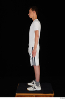 Johnny Reed dressed grey shorts sneakers sports standing white t shirt whole body 0003.jpg