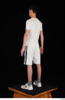 Johnny Reed dressed grey shorts sneakers sports standing white t shirt whole body 0004.jpg