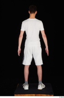 Johnny Reed dressed grey shorts sneakers sports standing white t shirt whole body 0005.jpg