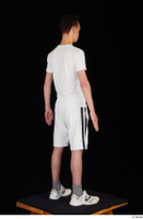 Johnny Reed dressed grey shorts sneakers sports standing white t shirt whole body 0006.jpg