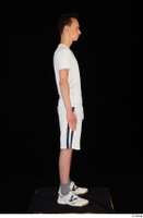 Johnny Reed dressed grey shorts sneakers sports standing white t shirt whole body 0007.jpg