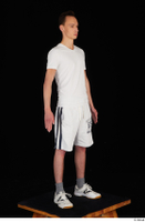 Johnny Reed dressed grey shorts sneakers sports standing white t shirt whole body 0008.jpg