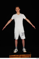 Johnny Reed dressed grey shorts sneakers sports standing white t shirt whole body 0009.jpg