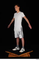 Johnny Reed dressed grey shorts sneakers sports standing white t shirt whole body 0010.jpg