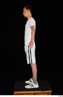 Johnny Reed dressed grey shorts sneakers sports standing white t shirt whole body 0011.jpg