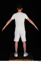 Johnny Reed dressed grey shorts sneakers sports standing white t shirt whole body 0013.jpg