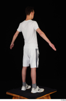 Johnny Reed dressed grey shorts sneakers sports standing white t shirt whole body 0014.jpg