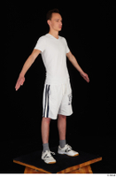 Johnny Reed dressed grey shorts sneakers sports standing white t shirt whole body 0016.jpg