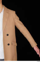 Johnny Reed arm brown coat business dressed upper body 0002.jpg