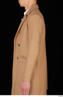 Johnny Reed arm brown coat business dressed upper body 0003.jpg