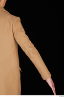 Johnny Reed arm brown coat business dressed upper body 0005.jpg