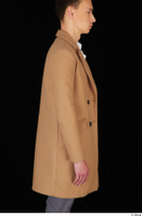 Johnny Reed arm brown coat business dressed upper body 0006.jpg