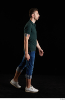 Trent  1 blue jeans casual dressed green t shirt side view walking white sneakers whole body 0002.jpg