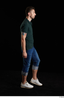 Trent  1 blue jeans casual dressed green t shirt side view walking white sneakers whole body 0003.jpg