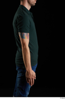 Trent  1 arm casual dressed flexing green t shirt side view 0001.jpg