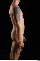 Trent  1 arm flexing nude side view 0001.jpg
