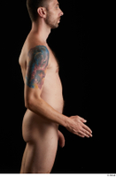 Trent  1 arm flexing nude side view 0002.jpg