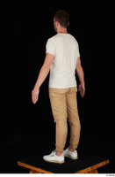 Trent brown trousers casual dressed standing white sneakers white t shirt whole body 0004.jpg