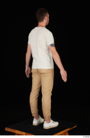 Trent brown trousers casual dressed standing white sneakers white t shirt whole body 0006.jpg