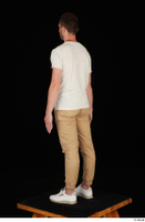 Trent brown trousers casual dressed standing white sneakers white t shirt whole body 0012.jpg