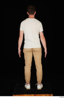 Trent brown trousers casual dressed standing white sneakers white t shirt whole body 0013.jpg