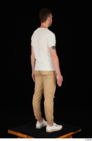 Trent brown trousers casual dressed standing white sneakers white t shirt whole body 0014.jpg