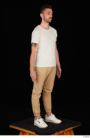 Trent brown trousers casual dressed standing white sneakers white t shirt whole body 0016.jpg