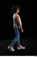 Elissa  1 blue jeans casual dressed side view walking white sneakers white t shirt whole body 0005.jpg