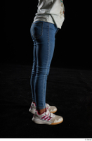 Elissa  1 blue jeans casual dressed flexing leg side view white sneakers 0001.jpg