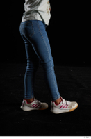Elissa  1 blue jeans casual dressed flexing leg side view white sneakers 0002.jpg